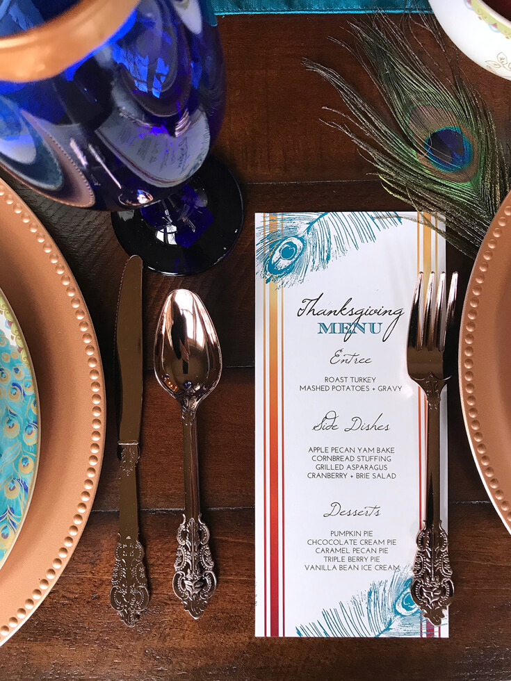 Peacock turquoise and copper FREE menu download. Editable file. See more Global Chic Holiday Tablescape ideas at Halfpint Design. Thanksgiving Tablescape, Place setting, Christmas Table, Holiday decor.