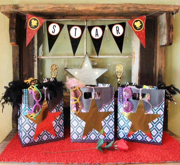 Movie Star party favors. Glittered sunglasses, feather boas, and VIP backstage passes for each guest. Perfect for a movie party, oscar party, or rock star party. On Halfpint Design.