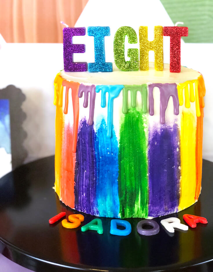 A watercolor and rainbow drip cake is perfect for an Art themed birthday party where you can party like Picasso! Halfpint Design. Art party, painting party, rainbow party.