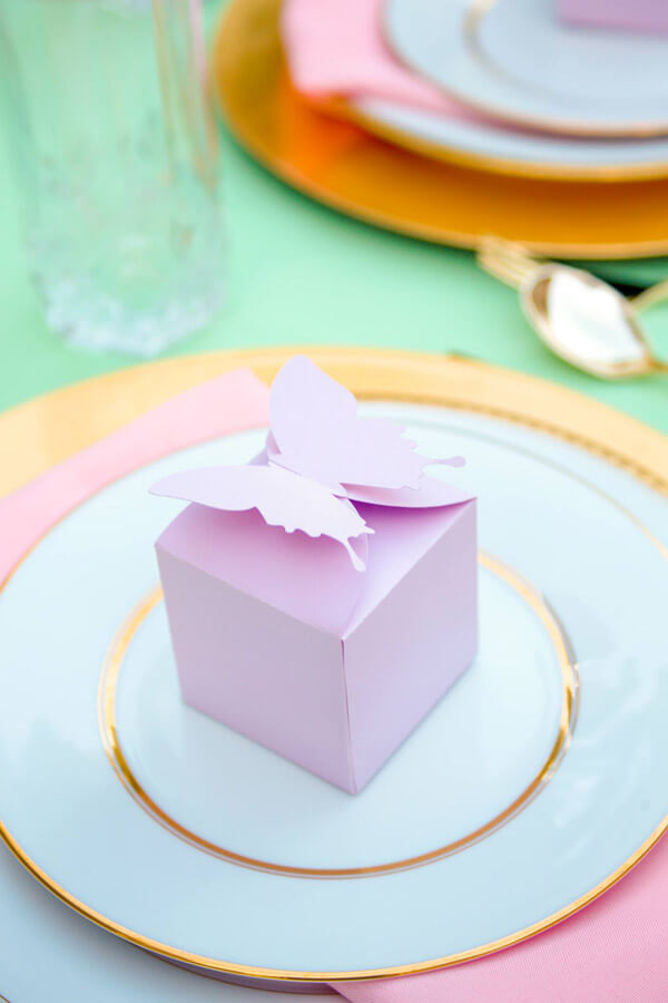 Pink favor box with butterfly topper for an Enchanted Butterfly party.