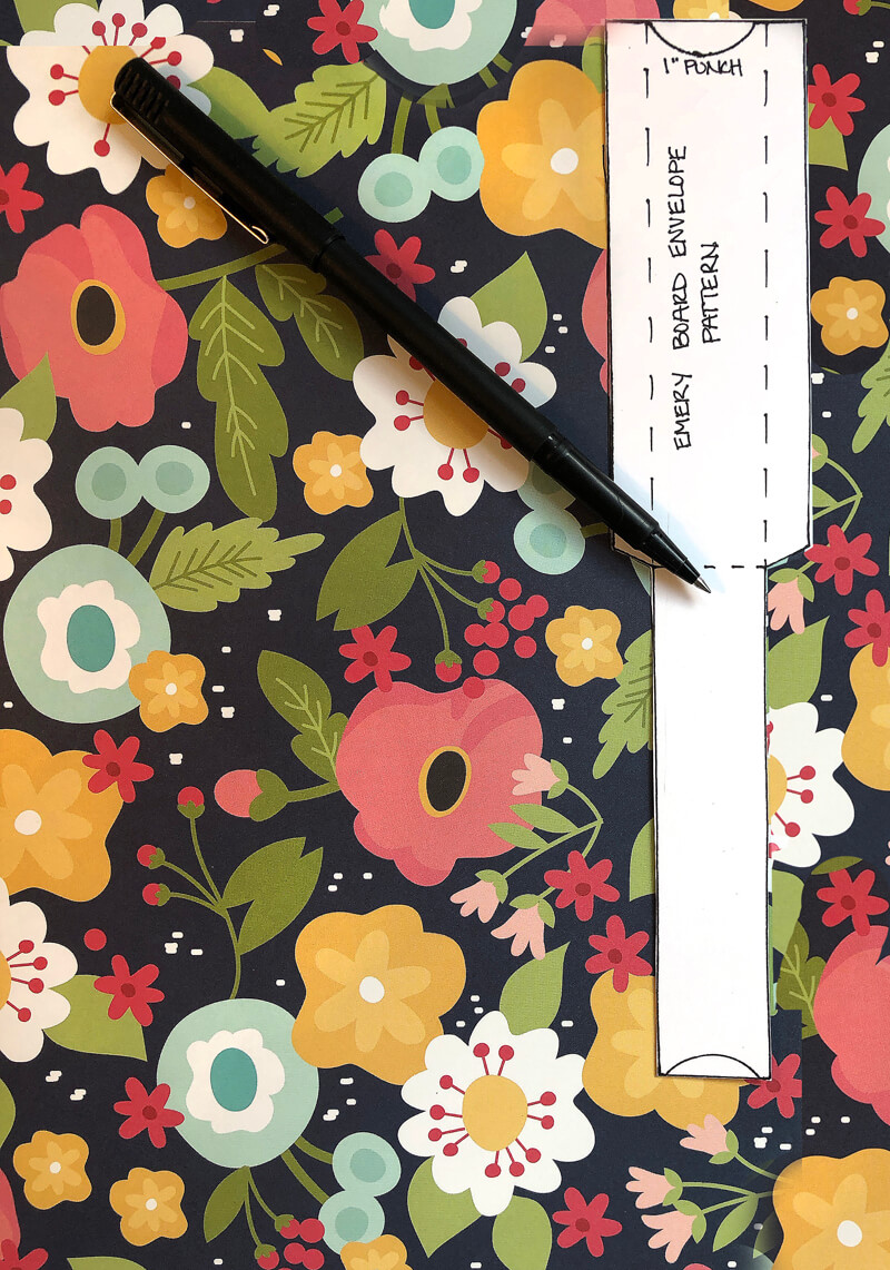 Tracing emery board cover template on colorful floral scapbook paper.