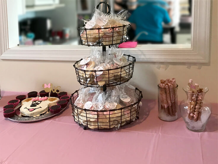 Tiered basket display for party favors for Minnie Mouse first birthday party