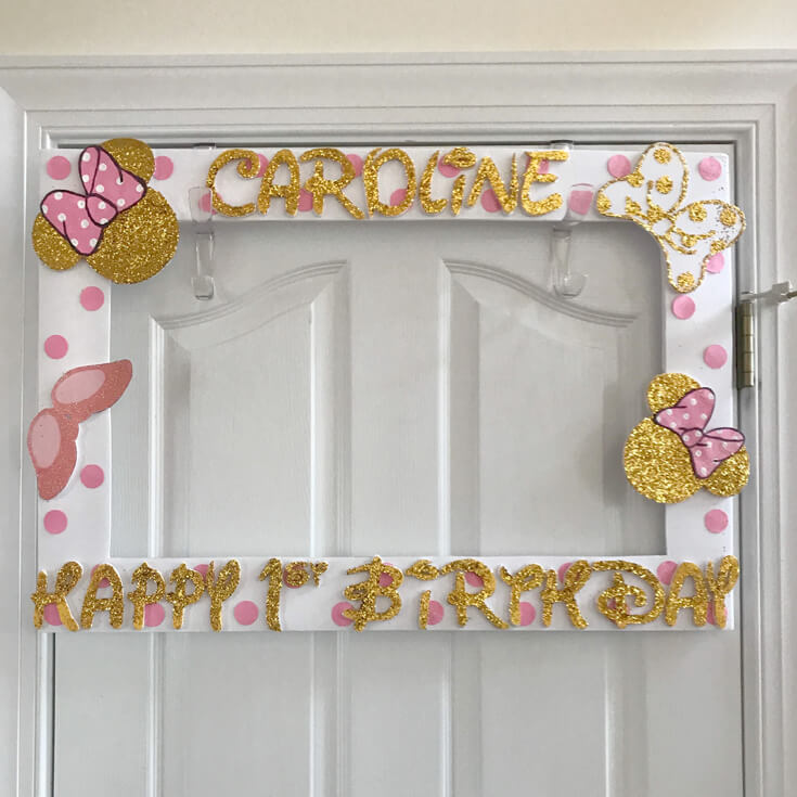 Custom photo backdrop for Minnie Mouse first birthday party