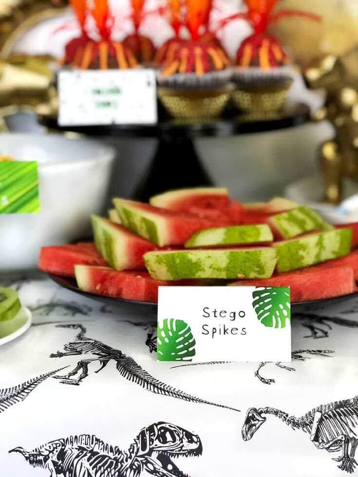 Watemelon triangles labeled Stego Spikes are a fun Naming regular foods something fun and festive is a great dinosaur birthday party idea!