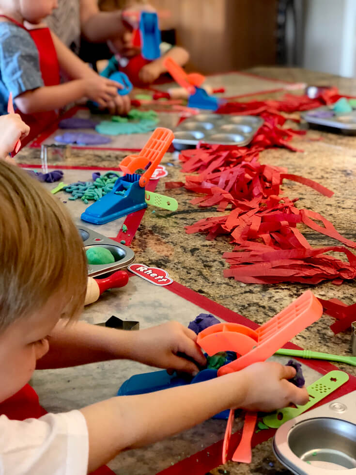 Little artists hard at work with their playdough creations for a Play-doh birthday party