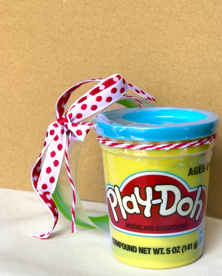 Play-doh party favor with cookie cutter tied on for a Play-doh birthday party