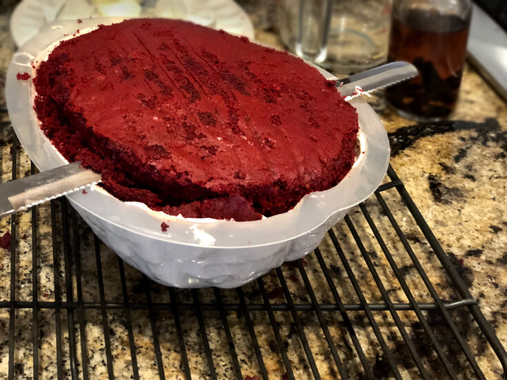 Slicing off the excess for a red velvet Brain Cake tutorial