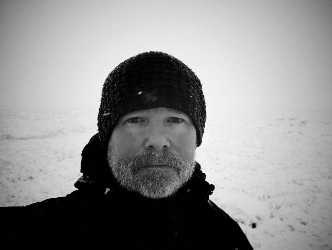 Mark Kelly - Hiker on the Marsden moors in the snow