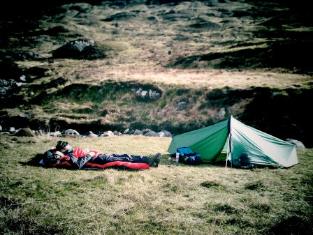 Hiker Sleeping outside Dibidil Bothy