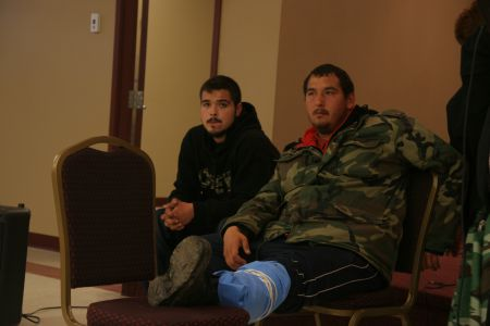 Tyson Peters addresses a crowd today at a community meeting in Elsipogtog. [Photo: Miles Howe]