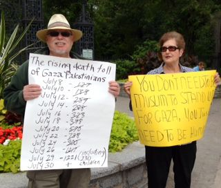 Larry and Linda protest the bombings of Gaza