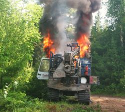 Shot-hole driller ablaze down the Bass River road. [Photo: Miles Howe]