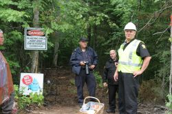 By now a familiar site. Police and security together bar entrance to SWN's seismic testing lines. [Photo: M. Howe]