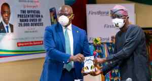 R-L: Babajide Sanwo-Olu, Lagos State Governor being presented with the Roducate e-learning device by Dr. Adesola Adeduntan, CEO, FirstBank to kick off the distribution of the preloaded Roducate e-learning devices to schoolchildren across the state in furtherance to the Bank's drive to move 1 million students to e-learning.