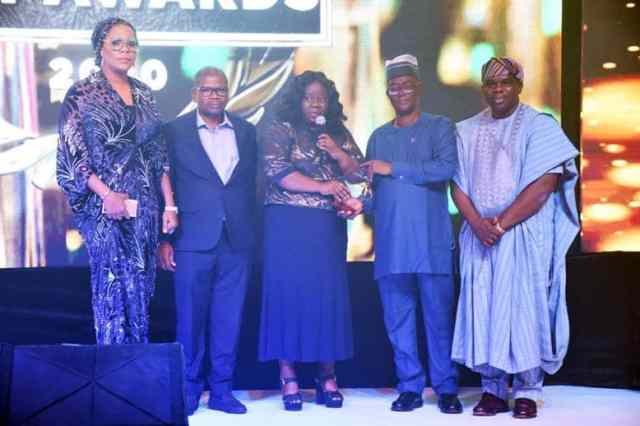 L-R: Mrs. Yetunde Adenaiya, Head, Human Resources, Central Securities Clearing System (CSCS) Plc; Mr. Johnson Onowugbeda, Corporate Communications, CSCS Plc; Mrs. Onome Komolafe, Divisional Head, Shared Services, CSCS Plc; Mr. Magnus Nnoka, President, Risk Management Association of Nigeria (RIMAN) & Chief Risk Officer, Coronation Merchant Bank; and Dr. Ogor Okiti, Managing Director, BusinessDay Media Limited during the presentation of Securities Services Company of the Year Award to CSCS Plc at the 8th Annual Banks' & Other Financial Institutions Awards 2020 on Saturday