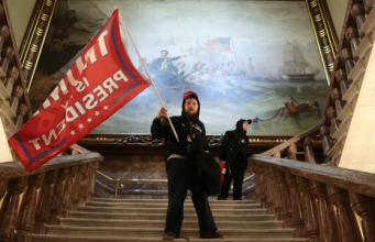 Trump supporter waves flag inside the Capitol Hill