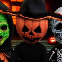 Mezco Unveils 'Halloween III' Silver Shamrock Living Dead Dolls Set