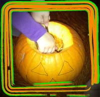 sccoping out the pumpkin