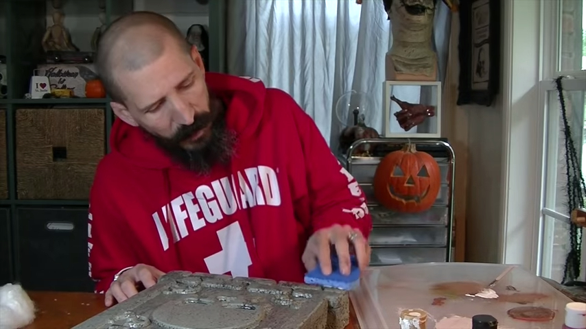 Upgrade Your Cheap Dollar Store Halloween Tombstones By Sponging Paint