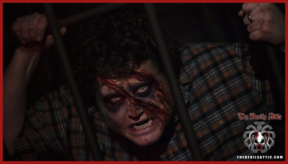 The Devils Attic Haunted House Sliced Face Man