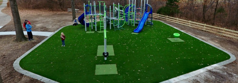 local Kansas playground with artificial grass installation