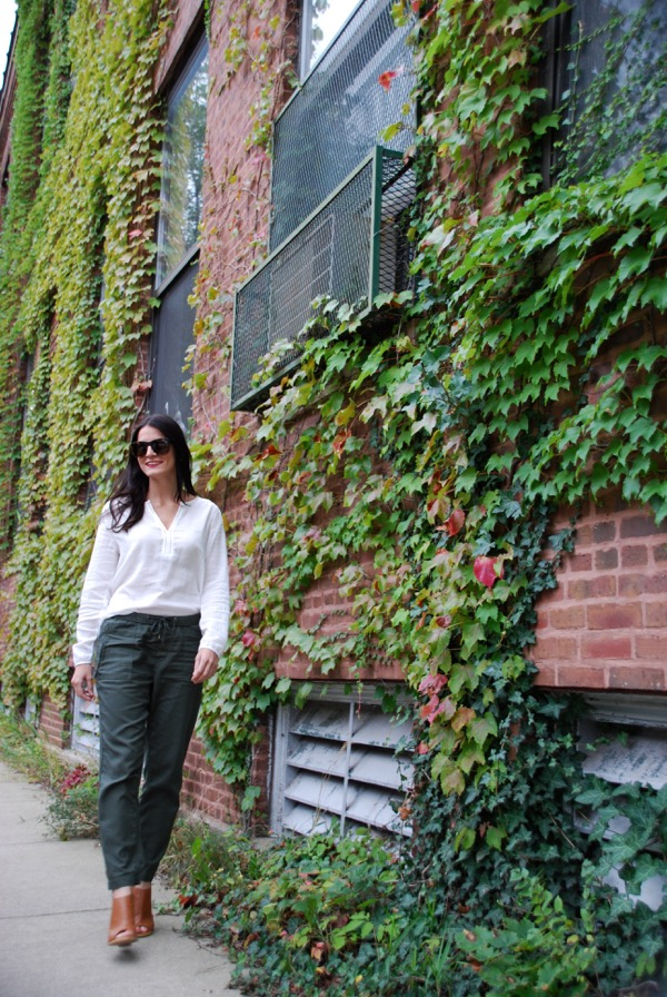 walking fast in front of ivy wall