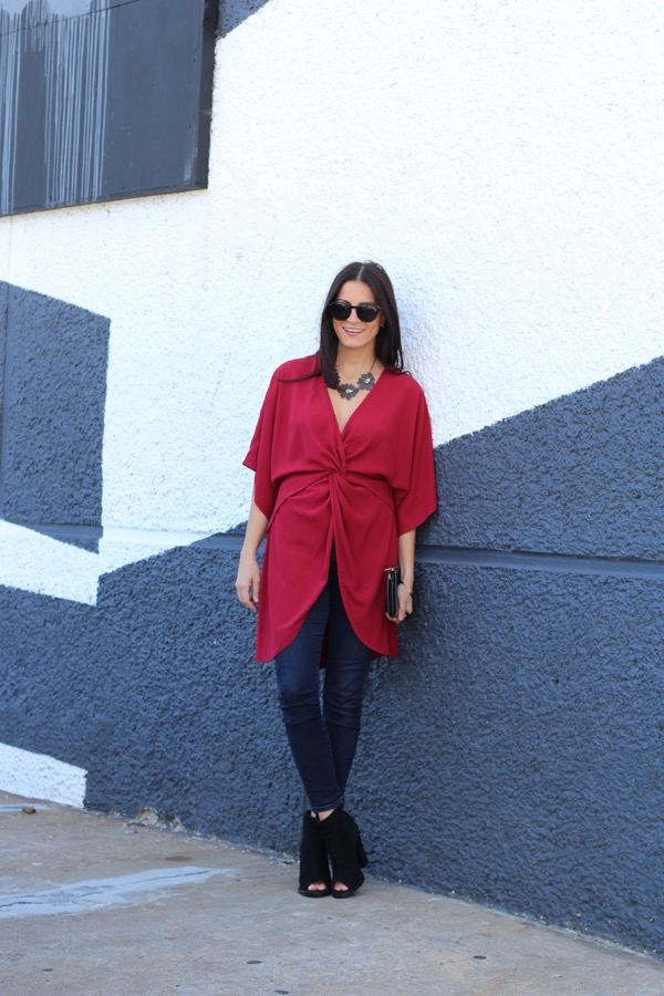 red wrap dress as a top with high waisted jeans and open toe booties