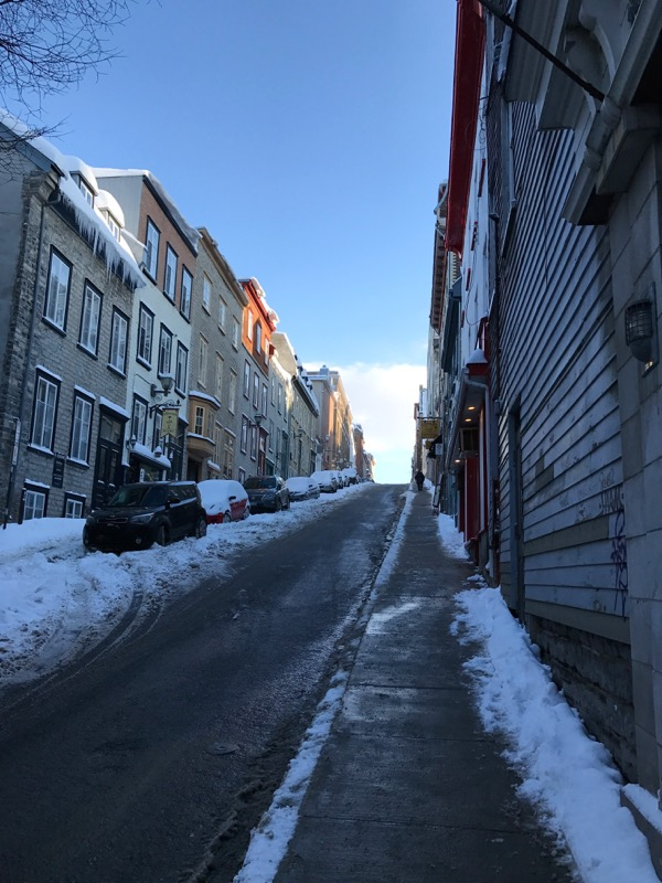 quaint snowy street in old town quebec city
