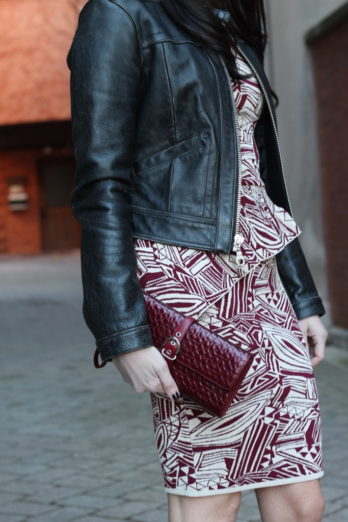 side peplum with coach clutch and gap leather moto jacket
