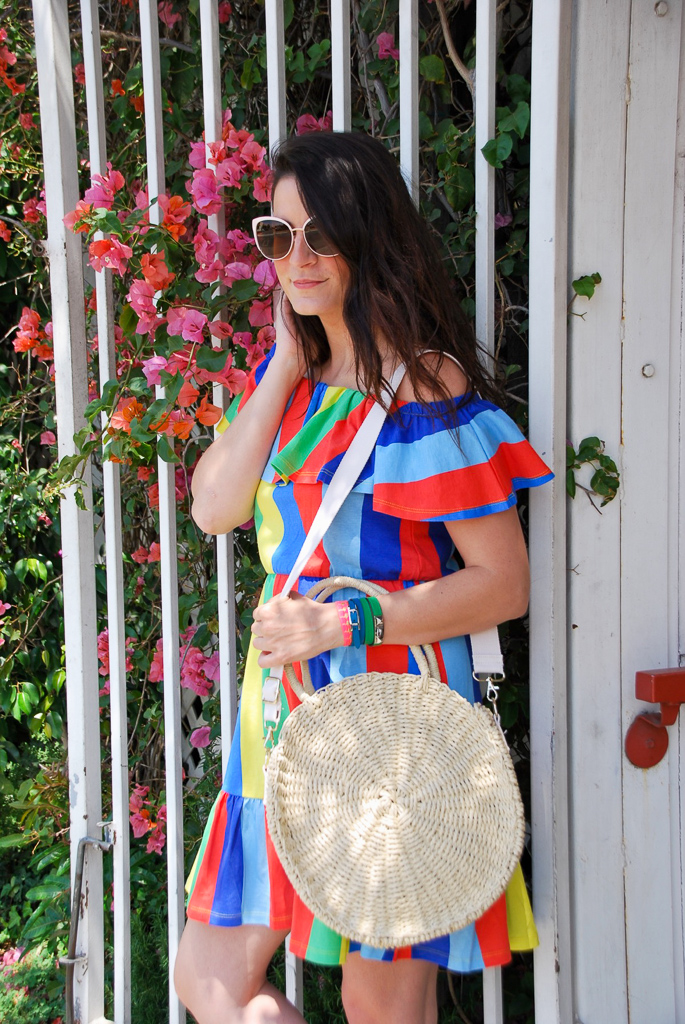 rainbow dress and round straw handbag