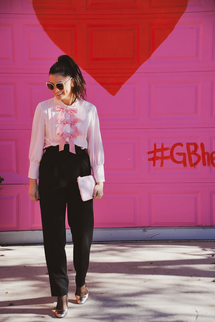 pink blouse and pink clutch