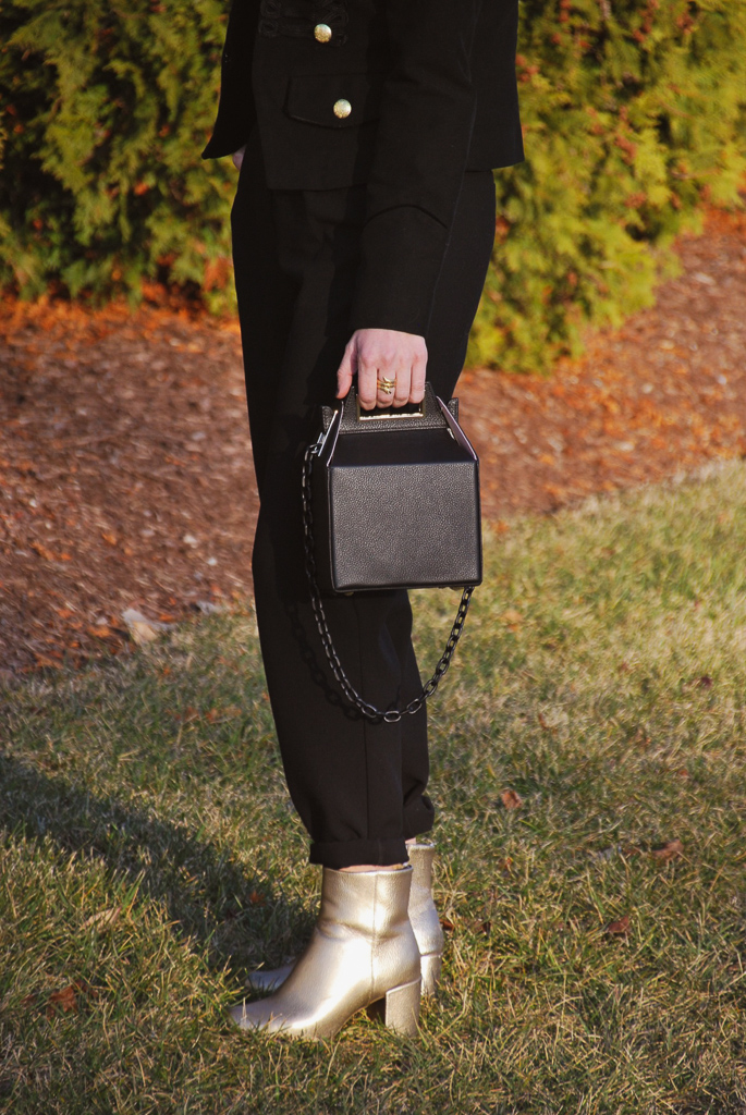 gold block booties and black carryout handbag