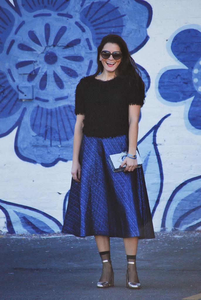 black fuzzy top and blue metallic midi skirt