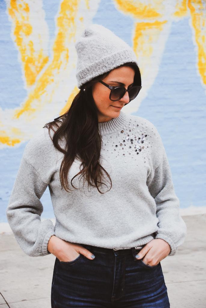 gray beanie and gray sweater