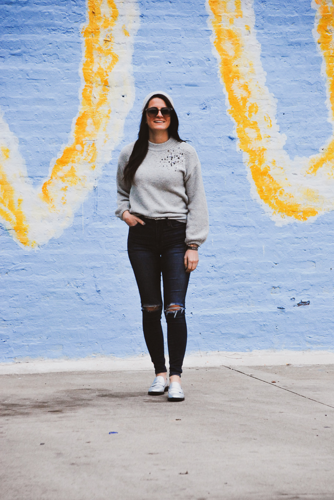 gray embellished sweater with distressed jeans