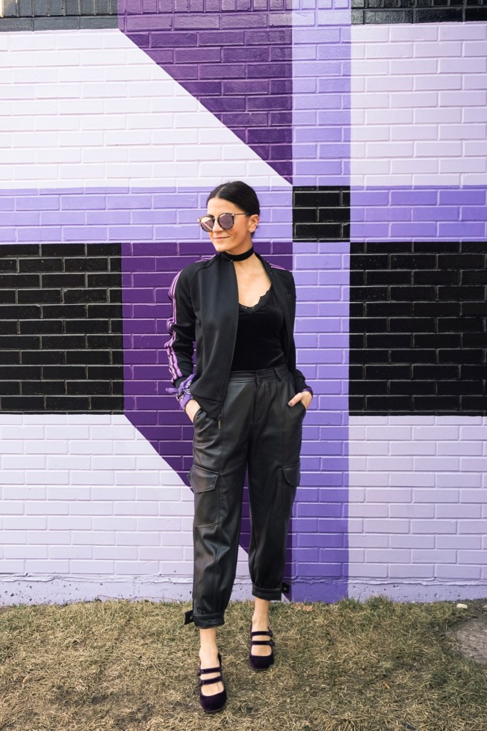 purple and black adidas jacket with black faux leather cargo pants