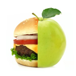 Half burger half apple concept isolated on white background