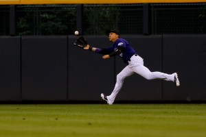 Carlos Gonzalez makes a running catch on a fly ball during the first inning of a game against the Philadelphia Phillies at Coors Field on May 18, 2015 (Justin Edmonds/Getty Images)