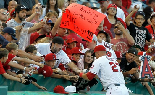 Los Angeles Angels' Mike Trout signs autographs as fans line up prior to a baseball game against the Texas Rangers on Friday, May 2, 2014, in Anaheim, Calif. (AP Photo/Alex Gallardo) ** Usable by LA and DC Only **