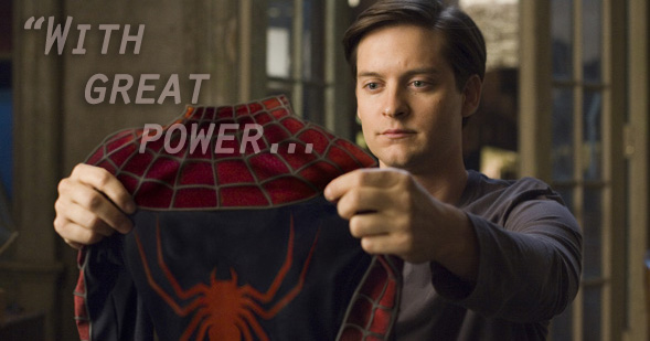 Toby McGuire in Spider-Man 2 holding up spider suit