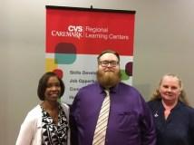 Chris with CVS employees Carla Hawkins and Winnie Jeffrey.