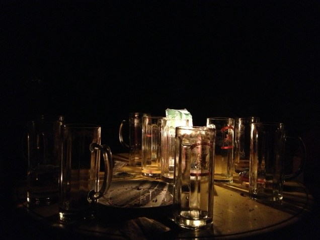 Beers by candlelight, thanks to intermittent power cuts