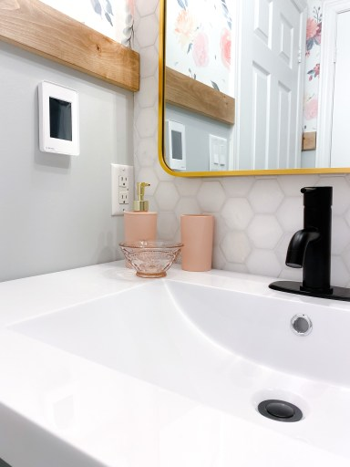 upclose of pink bathroom accessories