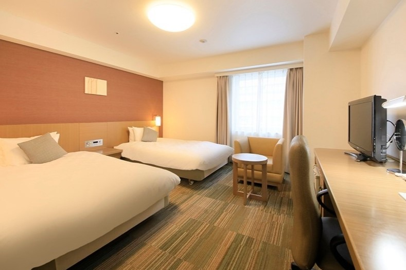 Standard Twin Room   Room Size: 28.6㎡   Bed Size: 122 cm x 203 cm   Capacity: 1-2 persons  