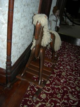 rocking horse, upstairs hallway