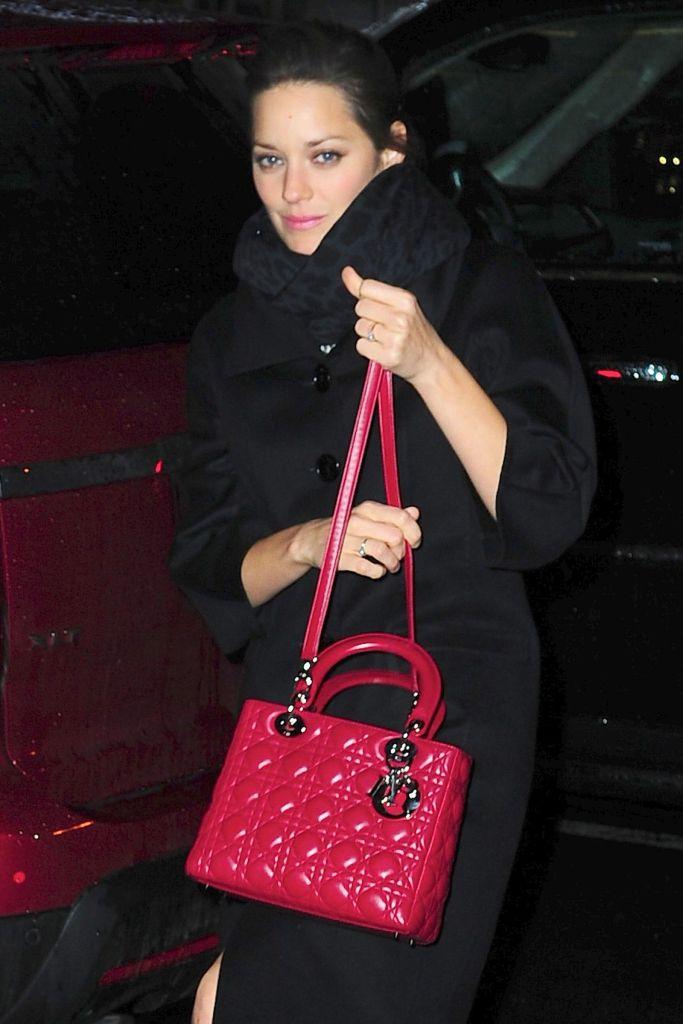 Marillon Cotillard with a Lady Dior shoulder bag