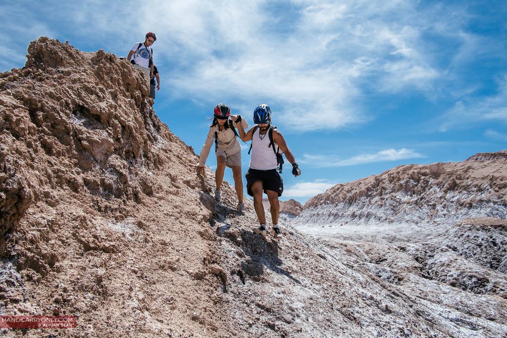 climbing down slope, valle de la luna, atacama, chile