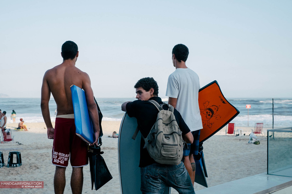 three surfers on copacabana