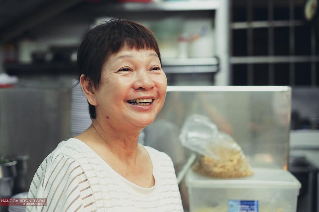 happy chicken rice lady