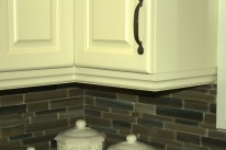 Beautiful lighting valence designed to match the door style and crown molding.